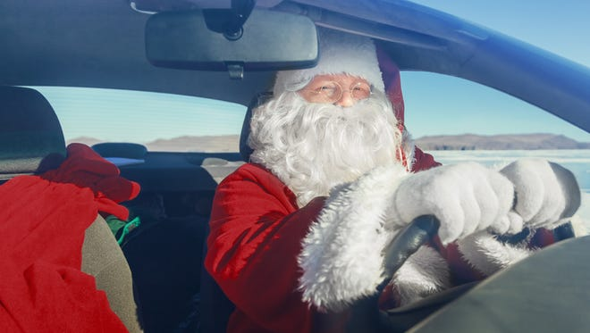 Portrait of Santa Claus in the car, shooting was conducted in a sunny day on lake Baikal