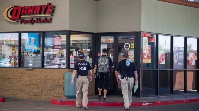 Federal agents raid Danny's Family Car Wash outlets in the Valley in August 2013.