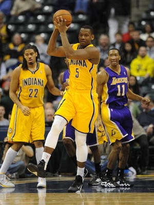 Indiana's Lavoy Allen looks to pass after grabbing a rebound in the fourth quarter as the Indiana Pacers defeated the Los Angeles Lakers 118-98 at Bankers Life Fieldhouse Tuesday February 25, 2014.