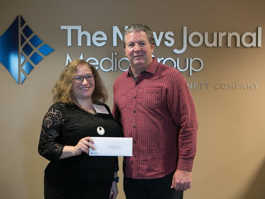 Dr. Stacey Fox with Beacon Pediatrics receives a Gannett Foundation Grant from Thomas Donovan, President/Publisher and Northeast Regional President of Gannett East Group.