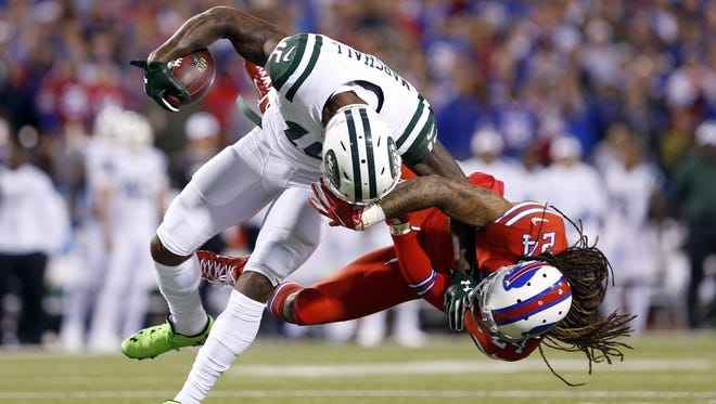 Buffalo Bills cornerback Stephon Gilmore drags Jets wide receiver Brandon Marshall down by the facemask during the first half at New Era Field Thursday night. Marshall left the game for a few plays after he went down awkwardly with his left leg twisted underneath his body.