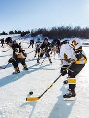 Waukesha Warhawks youth hockey players Cooper Hietala,