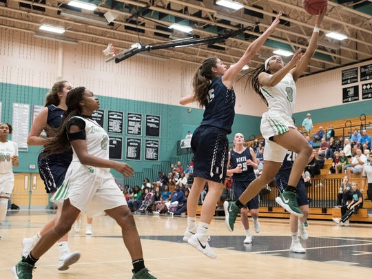 Fort Myers' Destanni Henderson goes up for a layup  in the Green Wave's 53-48 win over  Newtown (Pa.) Council Rock North Thursday in the Naples Holiday Shootout.