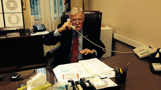 Richard Billings talks on the phone in the Rapides Parish Police Jury president's office Monday after being elected jury president. Craig Smith was elected vice president.