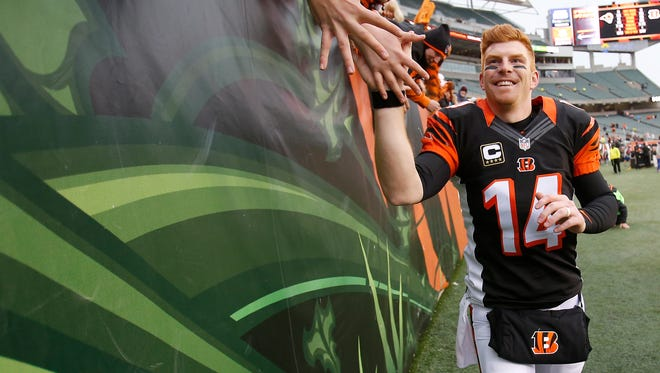 Bengals quarterback Andy Dalton high-fives fans after the 31-7 victory against the St. Louis Rams.