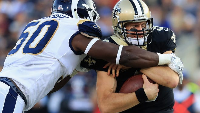 Rams rookie linebacker Samson Ebukam sacks Saints quarterback Drew Brees during last Sunday's game at the Coliseum. The rookie will be making his first NFL start this week against the Cardinals.