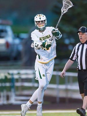 Medina's Jake Nanosky throws a pass during a lacrosse game last season.