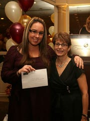 Raritan Valley Community College (RVCC) Nursing student Rachel Urban of Branchburg was awarded a $500 scholarship from the New Jersey League for Nursing. The prize was one of eight Nursing Scholarships awarded by the organization at its 2014 Nurse Recognition Awards Gala, conducted Nov. 7 at Pines Manor in Edison. Urban, left, is shown accepting her scholarship from Dr. Patricia Castaldi, president of the New Jersey League for Nursing. The scholarship awards, totaling $5,500, were given to RN students who are continuing their nursing education and to individuals who are pursuing a registered nurse degree. Other scholarship award winners represent Kean University, Felician College, Thomas Edison State College and Middlesex County College. The annual gala was attended by more than 400 nurses, their family and friends.