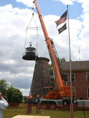 The lantern room is removed from the lighthouse tower on Aug. 14.