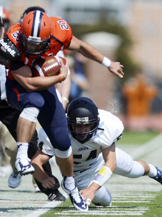 Gettysburg's Kyle Wigley is pushed out of bounds by Juniata's Luke Navin during a game in 2014. Wigley returns for his senior season with the Bullets. Last season, he amassed 731 yards and five touchdowns.