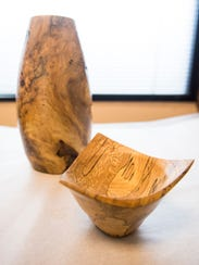 Wooden bowls are among the pieces of art shown in an