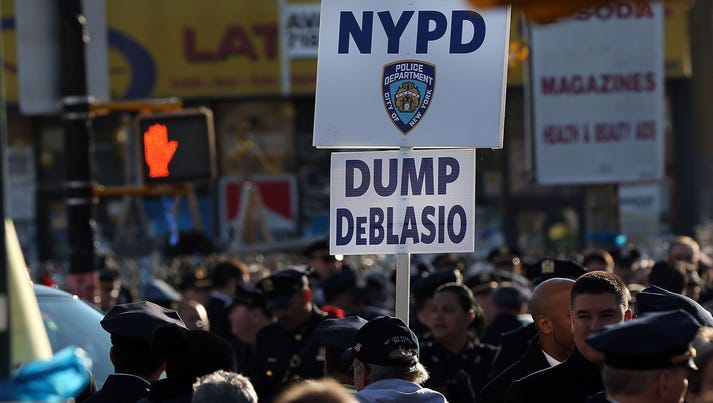 A protester holds up a sign against New York City's