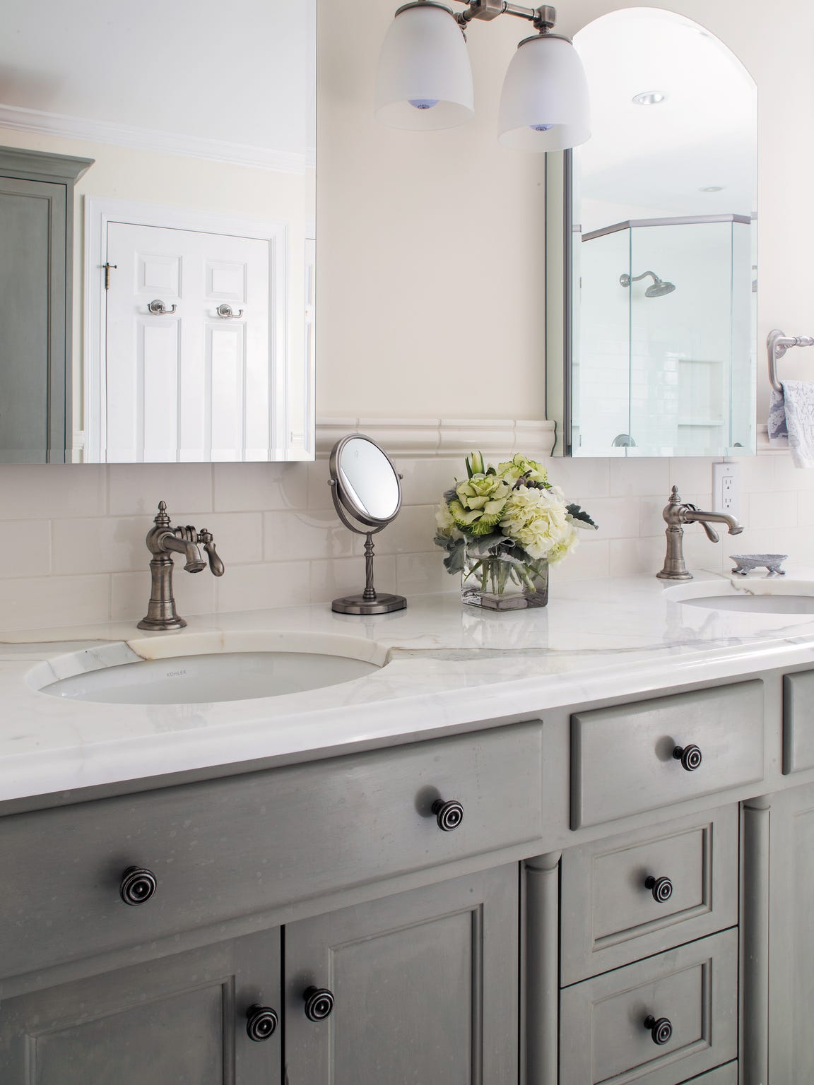 Gray and white carry through in bathrooms for a traditional-chic look.