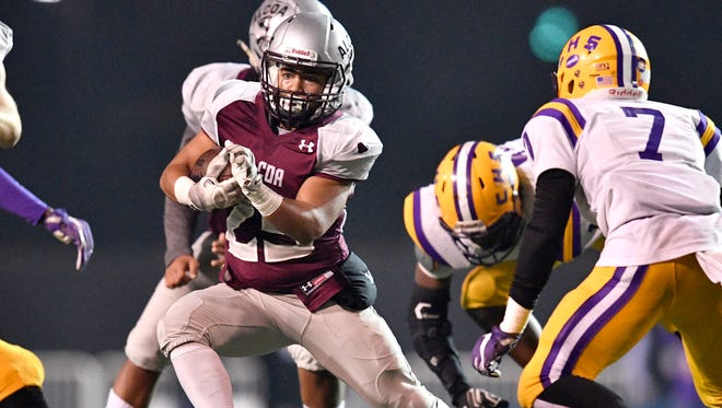 Alcoa's Jalen McCord (25) gains yards in the second half of the Class 3A state championship game at Tucker Stadium in Cookeville, Tenn., Thursday, Nov. 30, 2017.