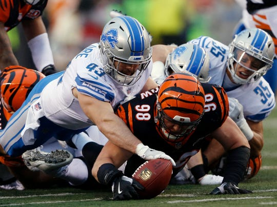 Lions middle linebacker Nick Bellore (43) and Bengals