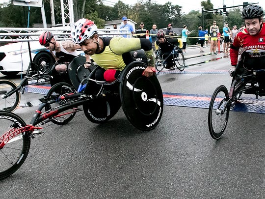 The wheelchair division leaves the starting line at the  Murfreesboro Half Marathon in 2015.