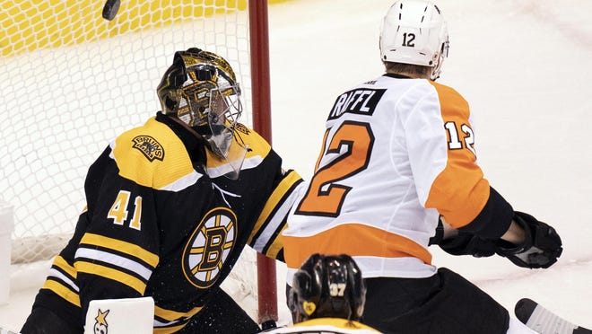 Philadelphia Flyers left wing Michael Raffl scores against Bruins goaltender Jaroslav Halak during second-period Sunday in Toronto.