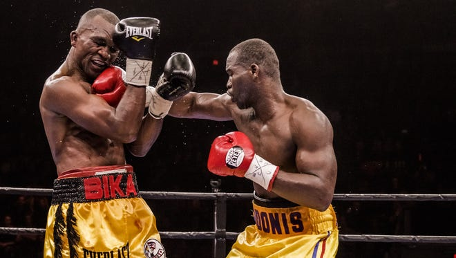 Adonis Stevenson, right, connects on a right hanbd to the jaw of Sakio Bika on Saturday.