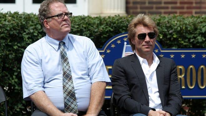 Jon Bon Jovi sits beside Sayreville mayor Kennedy O'Brien in the borough in 2013.