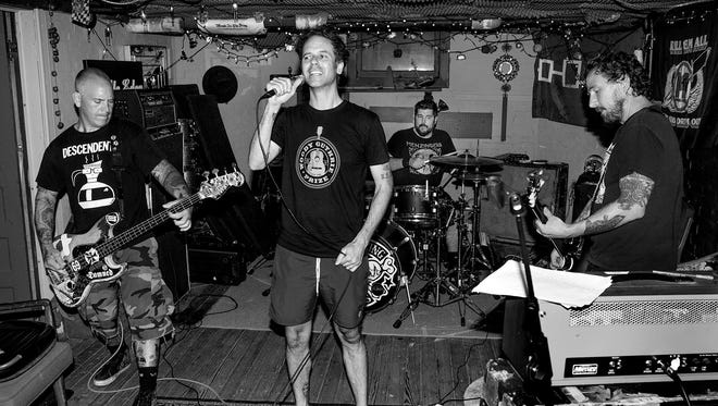 The Bouncing Souls, from left: Bryan Kienlen, Greg Attonito, George Rebelo, and Pete Steinkopf.