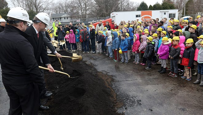 St. Charles Parish and School children watch as shovels of dirt are overturned during a groundbreaking ceremony Monday, March 6, 2017, for the first phase of the Cornerstone Project addition that will add much-needed classroom space.