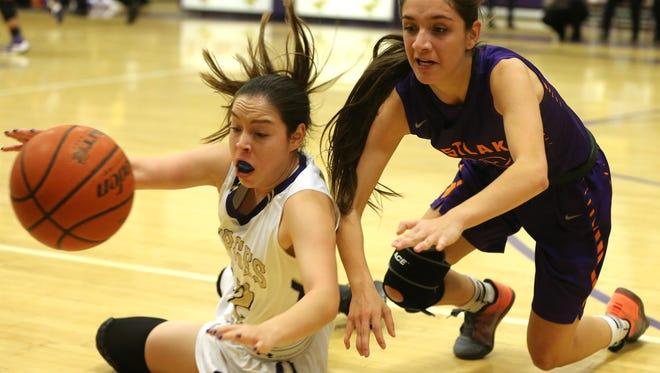 Burges' Julie Jacquez, left, and Eastlake's Daniela Gutierrez chased the loose ball along a sideline Monday at Burges.