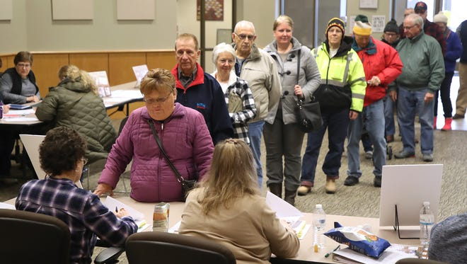 The voter lines at the Bellevue municipal steadily in Bellevue Tuesday morning where more than 500 voters had cast ballots before noon.