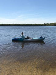 Laurie K. Blandford kayaks in the Indian River Lagoon