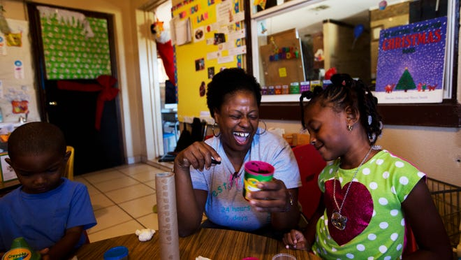 Nicki Preston, owner/teacher at Preston Family Child Care in Fort Myers, shares a fun moment with student Samiya Boston, 4, in December.
