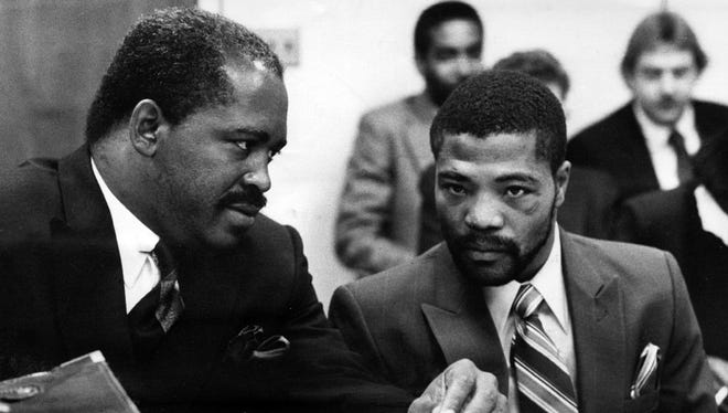 Mr. Gaines (left) working as an attorney in 1986. He later became a Hamilton County Municipal Court judge.