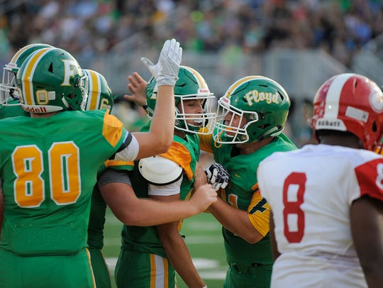 Floyd Central's Jason Cundiff (center) celebrates with