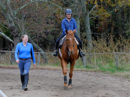 Caitlynn Tobin, who owns The Equestrian Experience, a business that offers horseback riding lessons, teaches Natali Formanek, 26, of Wall, aboard Kinkaid, at White Pine Farm in Howell, NJ Thursday, November 3, 2016.