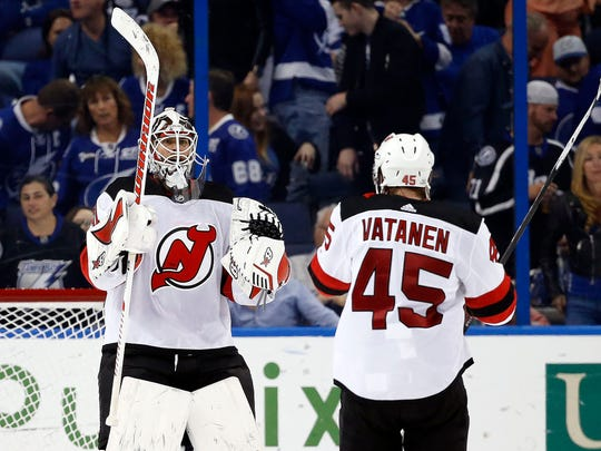 Feb 17, 2018; Tampa, FL, USA; New Jersey Devils goaltender Eddie Lack (31) and defenseman Sami Vatanen (45) celebrate after defeating the Tampa Bay Lightning during the third period at Amalie Arena.