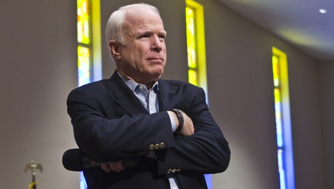 Sen. John McCain listens to a question from a member of the standing-room-only crowd of several hundred northeast Valley residents at Grace Bible Church in Sun City on Aug. 25, 2009. The main topic for the town-hall discussion was the health insurance reform legislation before Congress. The predominately pro-McCain group supports his stand against government-sponsored health insurance and against many of the other reforms being proposed.