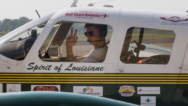 """Mason Andrews waves to the crowd of spectators from his plane as he begins to taxiing to the runaway to begin his solo circumnavigation flight around the world from the Monroe Regional Airport in Monroe, La. on July 22. """"It's really exciting and speaks volumes to the Louisiana Tech Aviation Program,"""" Mason, an aviation student of La. Tech, will be the youngest person to perform a solo circumnavigation of the world upon his successful completion at age 18. Andrews is performing the flight to help raise money and awareness for Louisiana's MedCamps."""