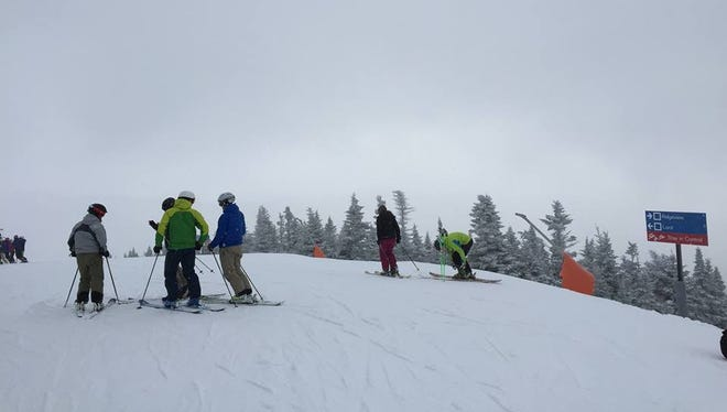 Skiers at the top of Mount Mansfield at Stowe Mountain Resort on Saturday, February 8.