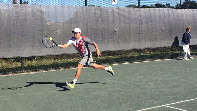 Pensacola Futures singles champion Henrik Wiersholm reaches for a forehand on Sunday during his 6-2, 1-6, 6-3 win over Alex Rybakov.