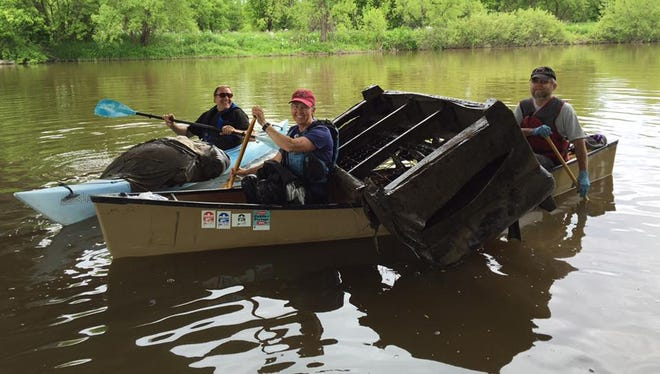 River cleanup crew with box spring.