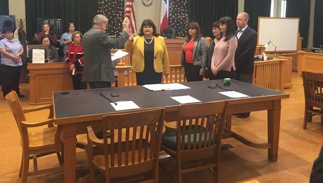 Tamara Cochran-May, the first female San Patricio County Attorney, was sworn in Friday, Dec. 30, 2016, by County Judge Terry Simpson.