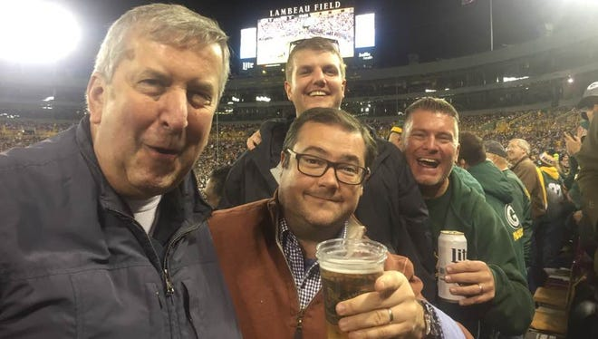 Draft Picks columnist John Holl (center with beer) with his family at a recent visit to Lambeau Field in Green Bay, Wisconsin.