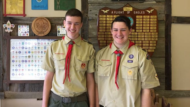 Sean Sullivan (left) and Brian Aitken stand in before Troop 53's Eagle Scout honor plaque after completing their boards of review.