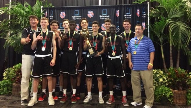 The 17-and-under Lone Wolf boys basketball program pose together after winning the Division II AAU national title on Sunday.