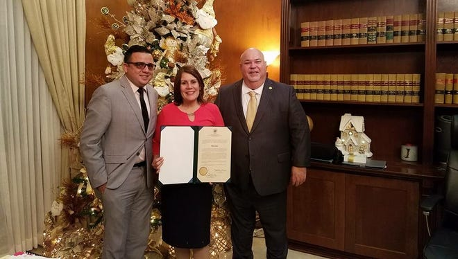 Perth Amboy Mayor Wilda Diaz was presented a proclamation for the city's efforts in helping victims of Hurricane Maria in Puerto Rico. From left: Felix Lassalle Toro, Puerto Rico's 16th District Representative; Mayor Wilda Diaz and Carols Mendez Nunez, president of the representative of Puerto Rico.