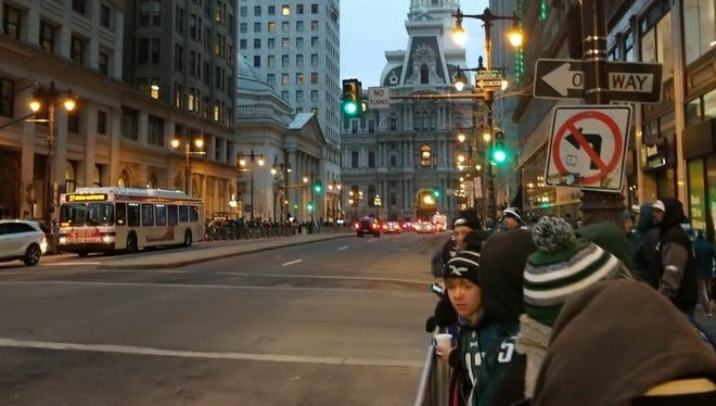 Eagles fans gather near City Hall in Philadelphia at 7:00 a.m. for the Super Bowl parade.