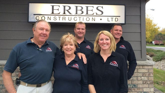 Mark Erbes, owner of Erbes Construction, left, stands with members of his family, from left, Marilee, Mark Jr., Julie and Rob.