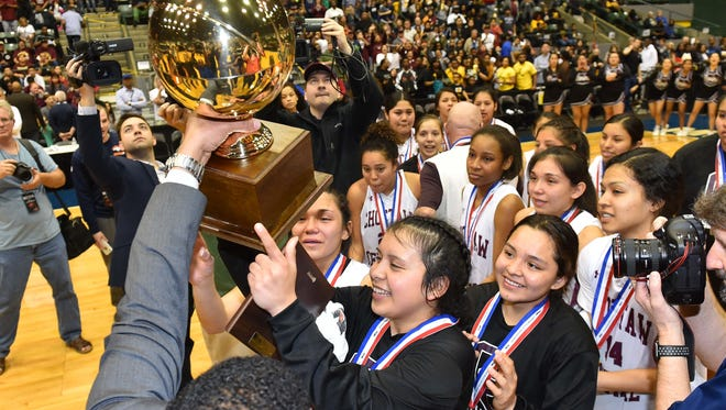 Choctaw Central players accept the trophy following their win over Independence in the MHSAA Girls 3A Championship Game held at The Coliseum in Jackson MS.(Photo/Bob Smith)