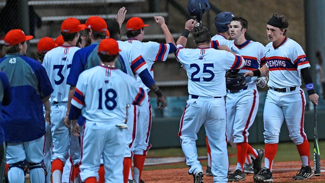 Northwestern State players congratulate David Fry.