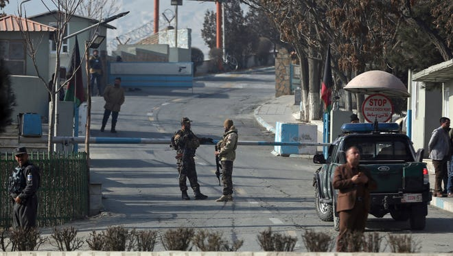Security forces stand guard at a gate of Intercontinental Hotel after the deadly attack, in Kabul, Afghanistan on Jan. 21, 2018.