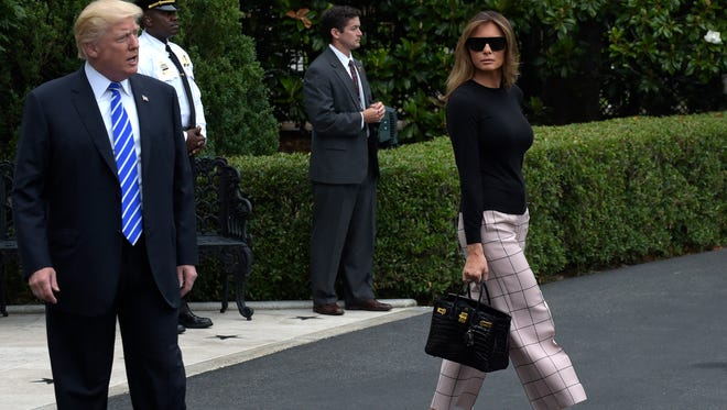 President Trump and first lady Melania Trump walk to Marine One on the South Lawn of the White House July 5, 2017, on their way to Poland and then Germany for the G20.
