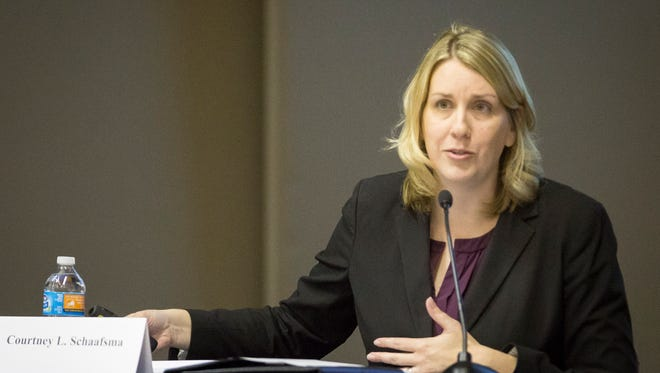Courtney Schaafsma, director of the state's Distressed Unit Appeal Board, talks with the Muncie community on May 1 about the State takeover of Muncie Community Schools.